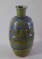Stoneware bottle vase with green <br/> ash glaze & iron inclusions by Ray Toms