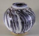 Stoneware moon jar with finger-wiped <br/> porcelain slip over Tenmoku glaze by Ray Toms