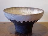Stoneware bowl with dark textured<br/> exterior, pale interior & rim runs by Paul Philp